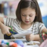Girl-crafting-GettyImages-138307943-58c068473df78c353cbd099f